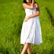 Stock Photo: Woman on green filed