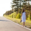 Woman walking along the road — Foto de Stock
