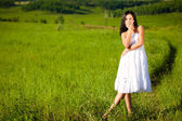 Woman on green filed — Stock Photo