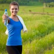 Sport woman holding water — Stock Photo