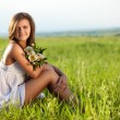 Woman sitting on field — Stock Photo