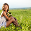 Woman sitting on field — Stock Photo #6721179