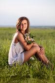 Woman sitting on field — Stock Photo