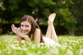 Woman laying on grass — Stock Photo
