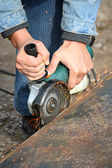 A grinding wheel cuts a metal — Stock Photo
