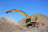 Dredge loads a rubble — Stock Photo