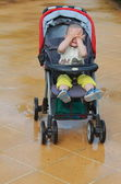 Funny baby in the stroller — Stock Photo