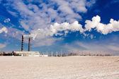 Factory in a winter season — Stock Photo