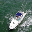Sportsfishing boat with blue canopy - Stock Photo