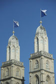 Flagged steeple of Grossmunster, Zurich — Stock Photo
