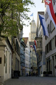 Zurich flagged old town and Grossmunster — Stock Photo