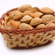 Almonds in wicker bowl — Zdjęcie stockowe
