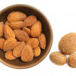 Almonds in the clay bowl — Stock Photo