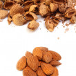 图库照片: Almond kernels with hulls