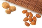 Almonds with bamboo mat — Stock Photo