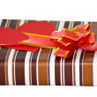 Stock Photo: Striped box with ribbon and heart shaped paper note for text