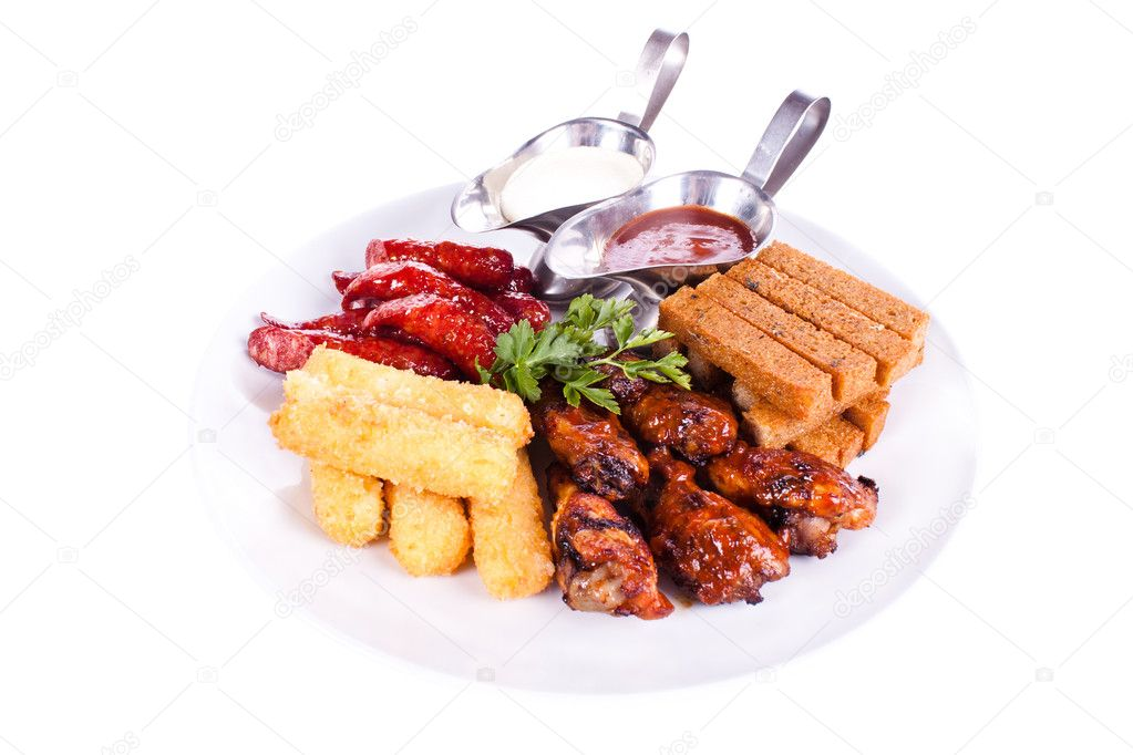 Meat dish with various meats, chicken, sausage, toast, potatoes. — Stock Photo #5654461
