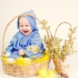 Funny child with easter eggs in basket — Stock Photo