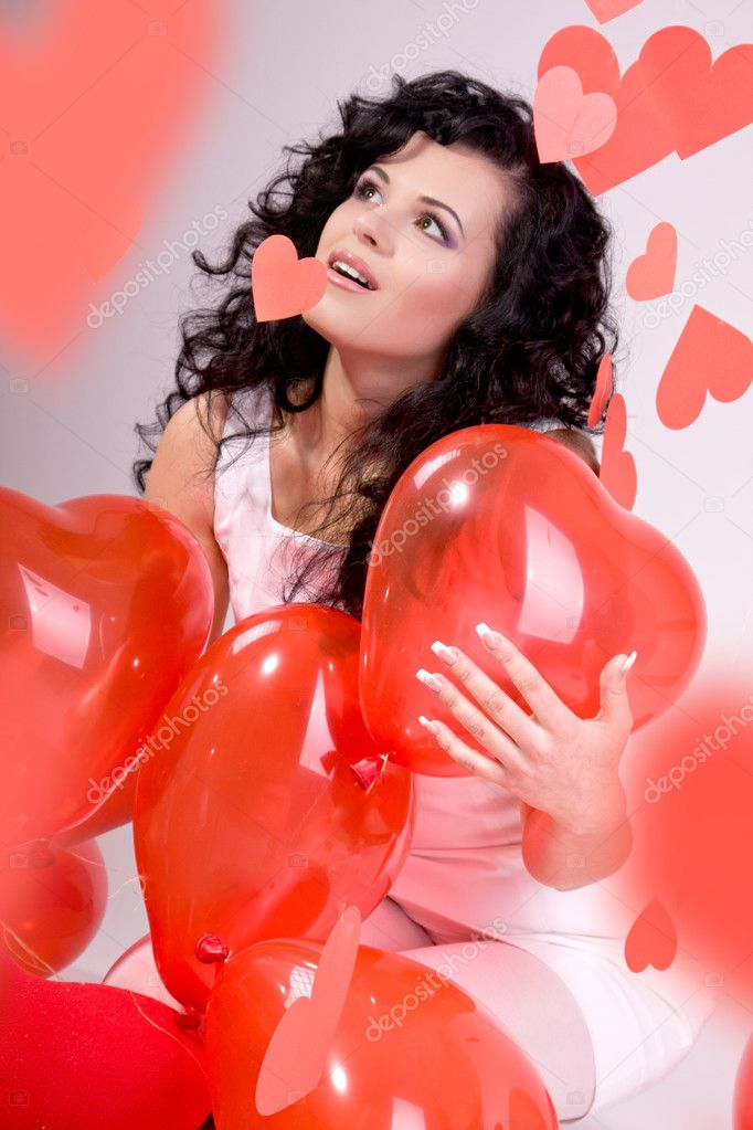 Woman with red heart balloon on a white background  Stock Photo #5619470