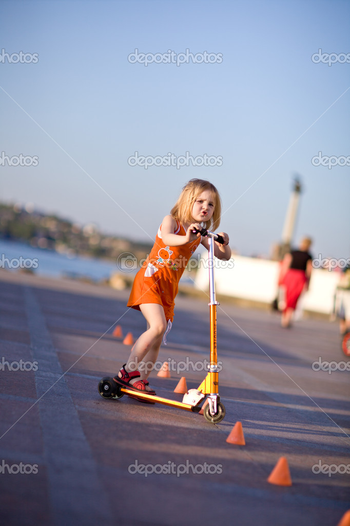 Pretty girl riding a scooter — Stock Photo #5750896
