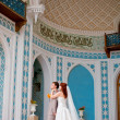 Stock Photo: Bride and groom in the palace