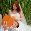 Bride and groom reed orange book — Stock Photo #5786629