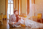 Bride and groom in the palace — Stock Photo