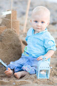 Baby boy playing on beach — Stock Photo