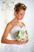 Lovely bride with bouquet of flowers — Stock Photo