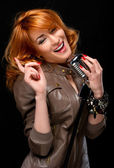 Portrait of a beautiful redhead singer — Stock Photo