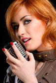 Beautiful woman singing — Stock Photo