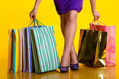 Female hands holding shopping bags — Stock Photo