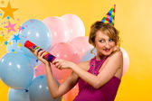 Beautiful young woman with firecracker — Stock Photo