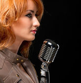 Beautiful redhead singer — Stock Photo