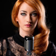 Gorgeous stylish redhead woman with retro microphone — Stock Photo