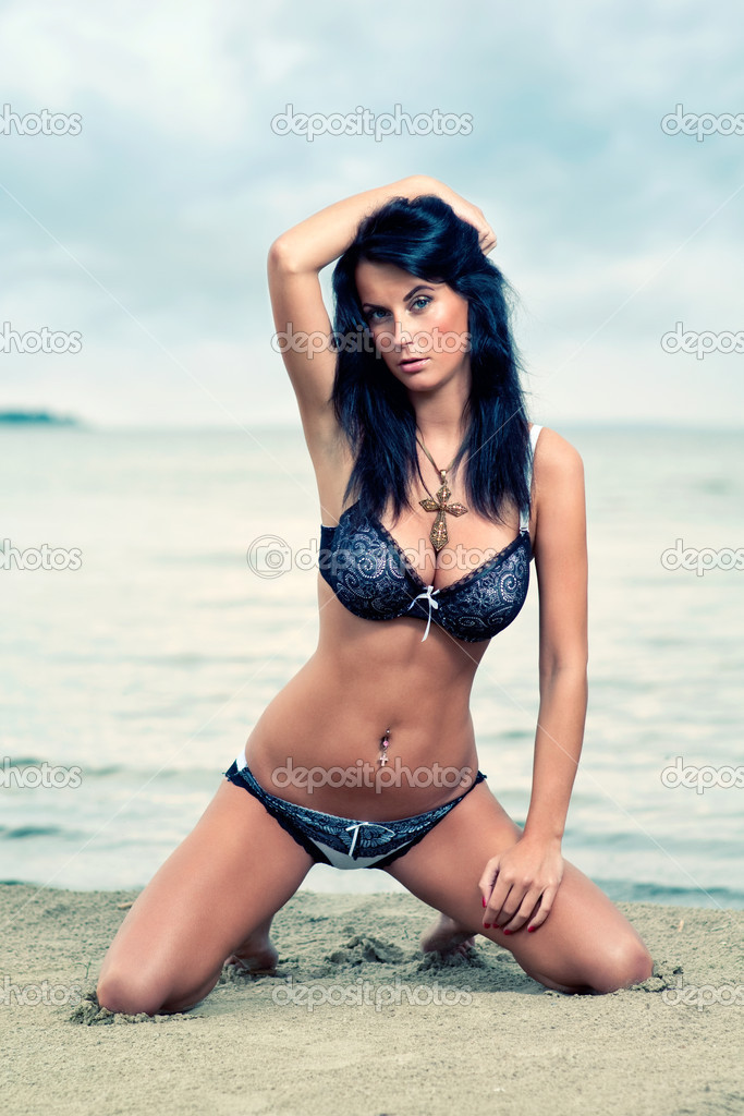 Beautiful young brunette relaxing on the beach  Stock Photo #5894316