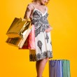 Lovely pregnant woman holding shopping bags — Stock Photo #5973864