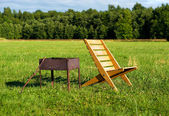 Armchair and barbecue — Stock Photo