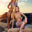 Two sexy girls posing on the beach — Stock Photo #6483881