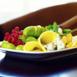 Cheese, grapes and redcurrant - Stock Photo