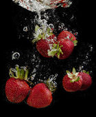 Strawberries in water — Stock Photo