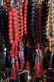 Prayer beads hanged on a wall — Stock Photo