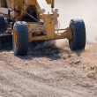 Road grader at work - Stock Photo