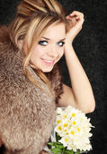 Blond with the bouquet — Stock Photo