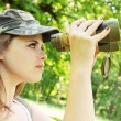 Girl the binoculars — Stock Photo