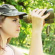 Girl the binoculars — Stock Photo