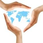 Female hands surrounding the world map on white — Stock Photo