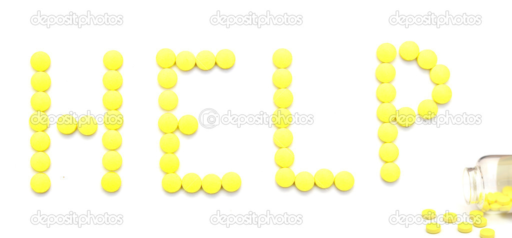 Yellow pills spelling the word help over white background  — Stock Photo #5447860
