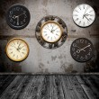 Collection of wall clock against an wall in old room — Foto de Stock