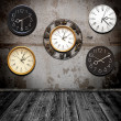 Collection of wall clock against an wall in old room — Stock Photo